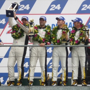 Gabriele on Stage with Trophy and Lonville G24 www.lonville.com www.lonvilleworld.com Gabriel Gardel races with Lonville Lonville Virage G24 at the 2011 Le Mans 2010 and 2011 GT winner Gabriele Gardel of Larbre Competition Corvette Racing